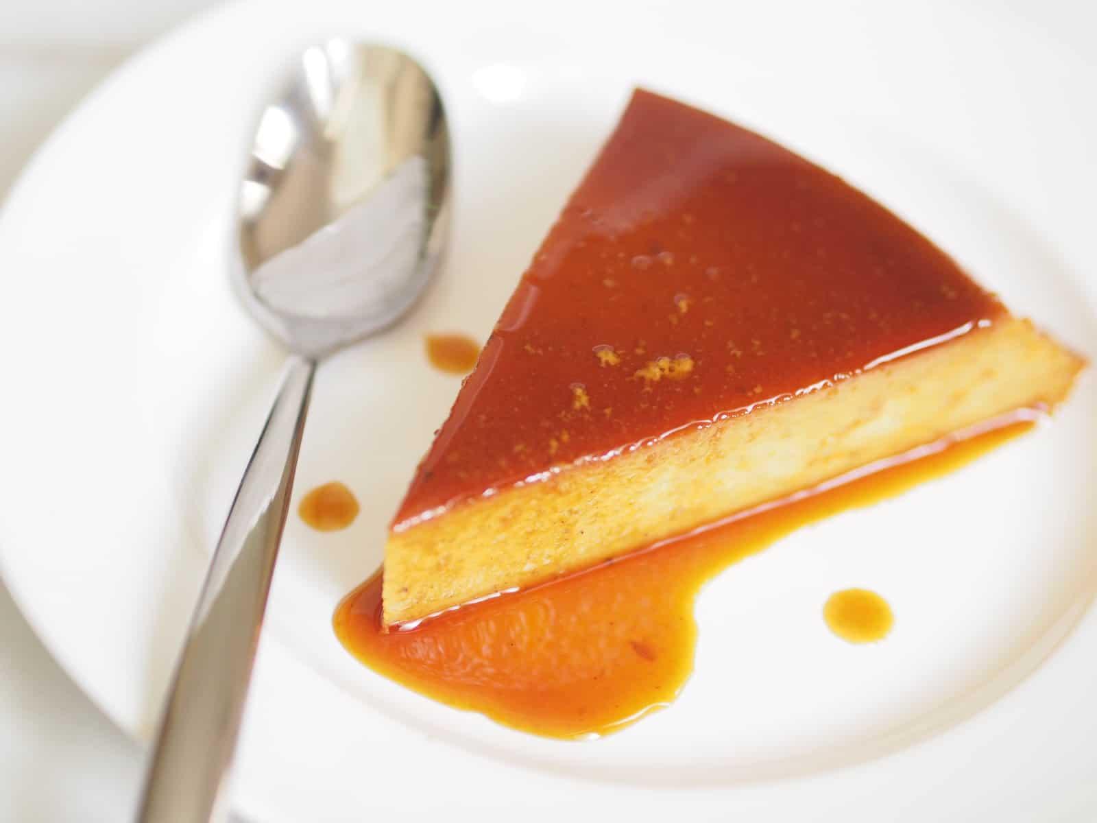 slice of flan de calabaza with a spoon