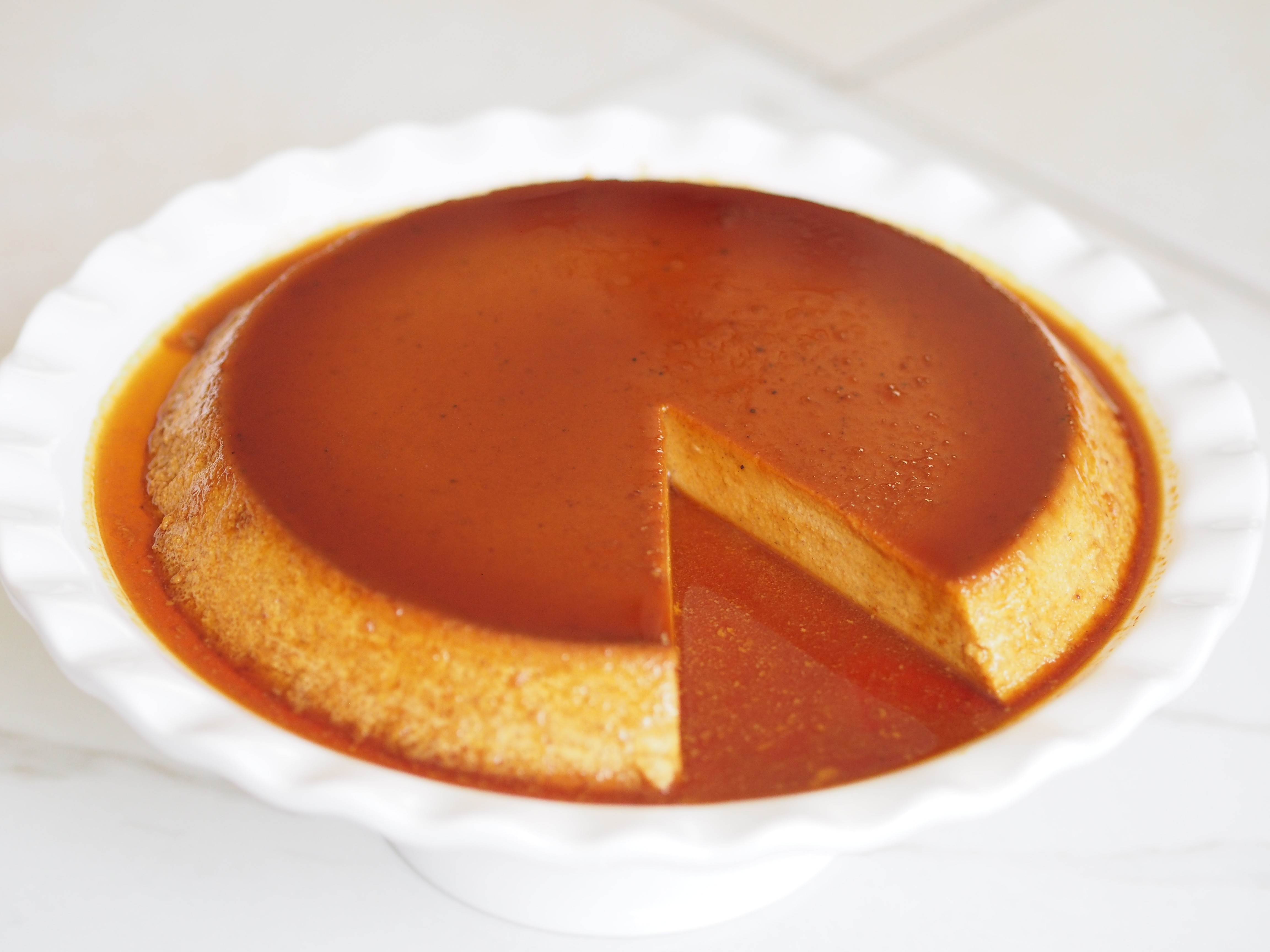 pumpkin flan with a slice cut out